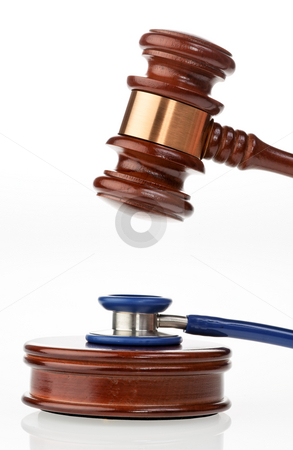 Stethoscope and Gavel stock photo, Stethoscope and gavel. Vertically framed shot. by Erwin Johann Wodicka