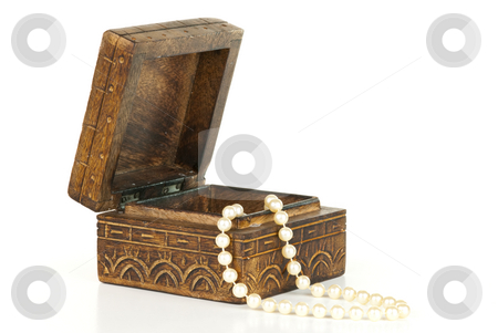Pearls in a box stock photo, Pearls in a open trinket box isolated on white background. by Tammy Abrego