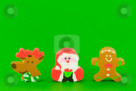 Christmas Background stock photo, Christmas erasers on green background. by Tammy Abrego