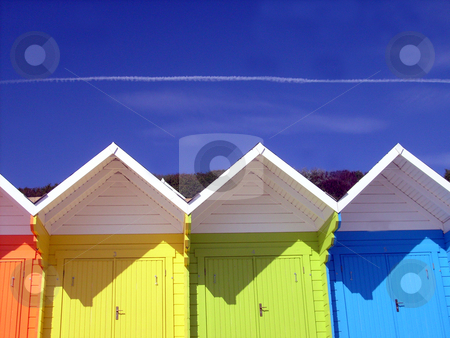 Colorful beach chalets stock photo, Low angle view of colorful wooden beach chalets in seaside resort of Scarborough, North Yorkshire, England. by Martin Crowdy