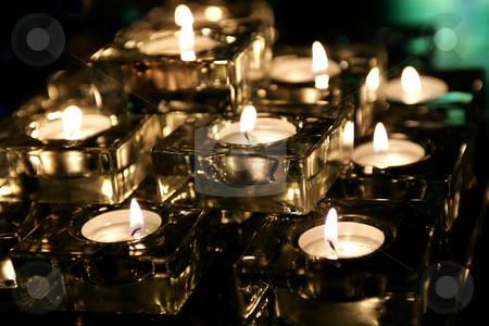 Burning tealight candles stock photo, Closeup of burning tealight candles indoors. by Martin Crowdy