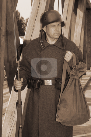 Retro styled picture with soldier stock photo, Old style picture with man in soldier uniform with weapon. Costume is authentic to the ones weared in time of  World War I. by Roberts Ratuts