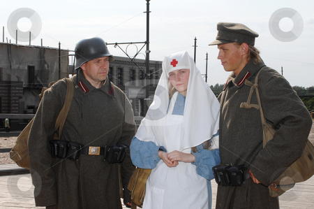 Retro styled picture with nurse and two soldiers stock photo, Old style picture with woman in nurse costume and two mans in soldier uniform. Costumes are authentic to the ones weared in time of  World War I. by Roberts Ratuts