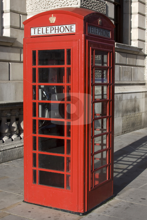 Phone box stock photo, British Red phone box with the word telephone across the top by Darren Pattterson