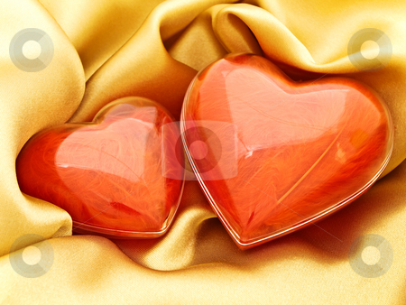 Red hearts at gold stock photo, Red hearts at golden fabric drapery background by Sergej Razvodovskij