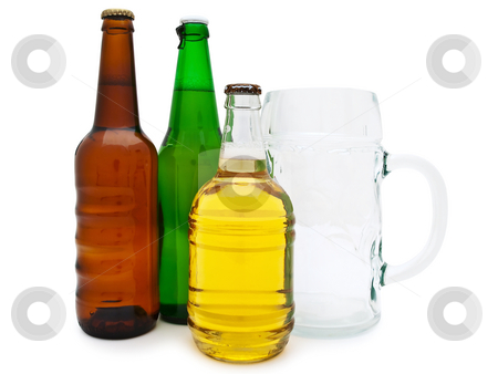 Beer stock photo, Multicolored bottles of beer with glass against the white background by Sergej Razvodovskij