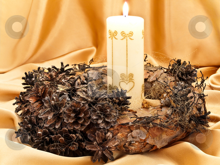Garland with candle stock photo, Handmade garland with candle against golden background by Sergej Razvodovskij