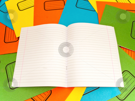 Notebook stock photo, Open lined notebook at the stack multicolored notebooks background by Sergej Razvodovskij