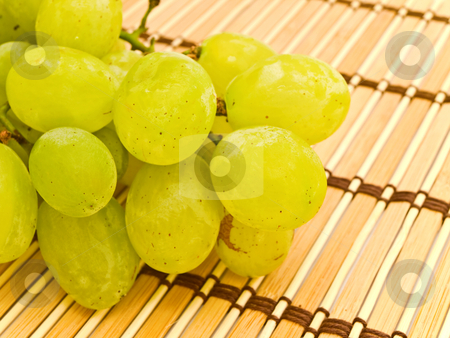 Grape at mat stock photo, Photo of the background with grape at mat by Sergej Razvodovskij