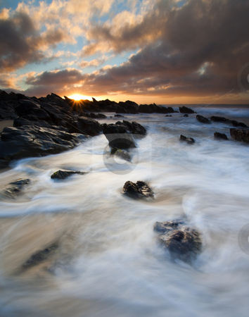 Boiling Tides stock photo, Tides swirling around jagged rocks on Basham Beach as the sun rises off the South Australia Coast by Mike Dawson