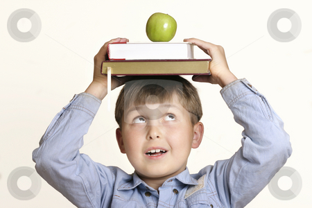 Scholastic stock photo, Schoolboy, textbooks, apple by Leah-Anne Thompson