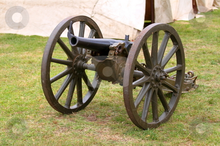 Canon stock photo, A Canon with a military camp in the background by Henrik Lehnerer
