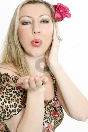 Beautiful female blowing air kisses stock photo, A woman lovingly blowing air kisses by Leah-Anne Thompson