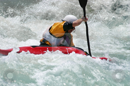 Battling the Rapids stock photo, Extreme action - A kayaker battling strong rapids by Leah-Anne Thompson