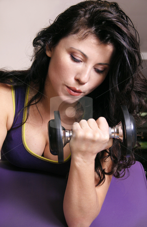 Gym fitness - Working out using hand weights stock photo, Woman in the gym using hand weights by Leah-Anne Thompson
