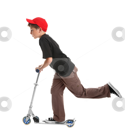 Child riding a scooter toy stock photo, Boy  leaning forward and pushing the scooter with one foot to pick up speed - on a white background. by Leah-Anne Thompson