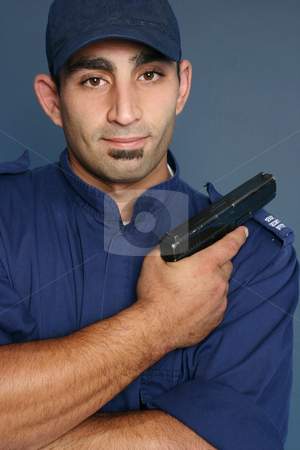 Security Personnel stock photo, Security officer wearing a blue uniform. by Leah-Anne Thompson