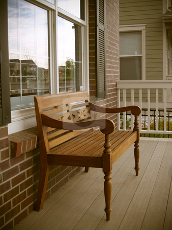 Bench stock photo, A bench sits on the front porch by Cora Reed