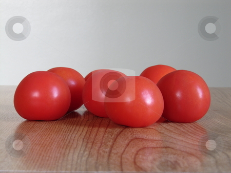 Tomatoes stock photo, Tomatoes on a table by Michael O'Connell