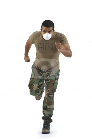 Military man in camouflage running with H1N1 mask stock photo, Military man in camouflage fatigue running with H1N1 mask action hero style. Nikon D90 85mm f/1.4 Nikkor lens by Anup Sugunan