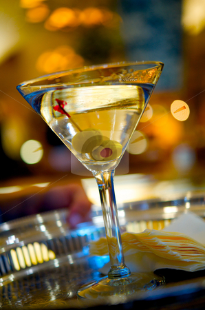 Martini on a silver serving tray stock photo, Close up image of a martini on a serving tray by Greg Blomberg