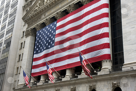 New York Stock Exchange stock photo, The New York Stock Exchange with one large US flag and three small ones. by Darren Pattterson