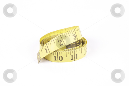 Tape Measure stock photo, Yellow curled tape measure with a reflective white background by Keith Wilson