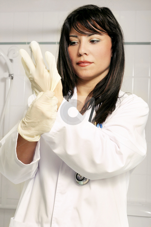 Scrubbing up stock photo, Doctor preparation procedure(occupational health safety) by Leah-Anne Thompson