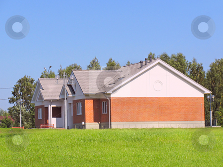 New Home stock photo, Suburban house of red brick surrounded by lawn by Olga Lipatova