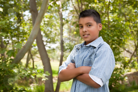 Handsome Young Hispanic Boy in the Park stock photo, Handsome Young Hispanic Boy Having Fun in the Park. by Andy Dean