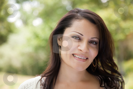 Attractive Hispanic Woman in the Park stock photo, Attractive Hispanic Woman Portrait in the Park. by Andy Dean