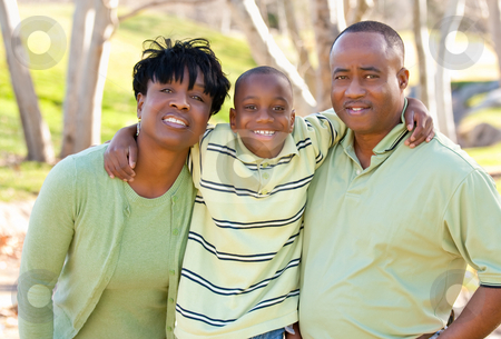 Happy African American Man, Woman and Child stock photo, Happy African American Man, Woman and Child Having Fun in the Park. by Andy Dean