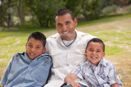 Hispanic Father and Sons in the Park stock photo, Hispanic Father and Sons Portrait in the Park. by Andy Dean