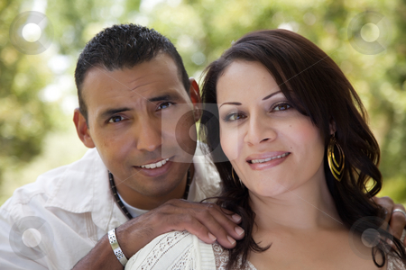 Attractive Hispanic Couple in the Park stock photo, Attractive Hispanic Couple Portrait in the Park. by Andy Dean