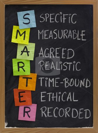 Smart (smarter) goal setting stock photo, SMARTER (specific, measurable, agreed, realistic, time-bound, ethical, recorded) - acronym for goal setting approach, white chalk handwriting, colorful sticky notes on blackboard by Marek Uliasz