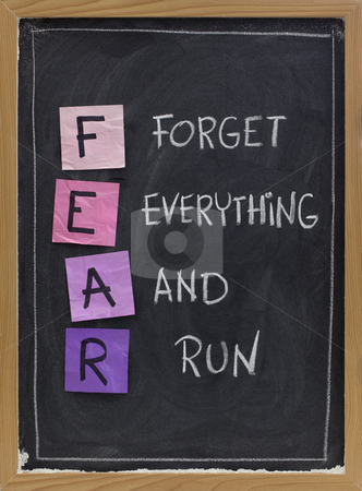 Forget everything and run stock photo, Forget everything and run - FEAR acronym, shutting down or panic response concept, white chalk handwriting and sticky notes on blackboard by Marek Uliasz