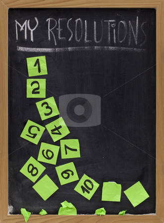 Fading new year resolutions stock photo, Concept of New Year resolution fading, being erased or falling apart - white chalk handwriting and green reminder notes on blackboard by Marek Uliasz