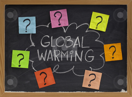 Global warming question stock photo, Concept of global warming question - doubt or unsolved problems, white chalk handwriting and colorful sticky noted on blackboard by Marek Uliasz