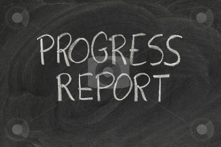 Progress report stock photo, Progress report headline handwritten with white chalk on blackboard with eraser smudges by Marek Uliasz