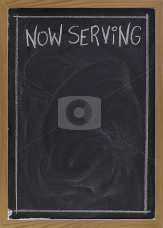 Now serving on blackboard stock photo, Now serving - white chalk handwriting on blackboard with blank space below for a menu by Marek Uliasz