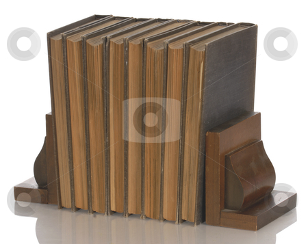 Vintage books and bookends stock photo, Old books held up with wooden bookends with reflection on white background by John McAllister