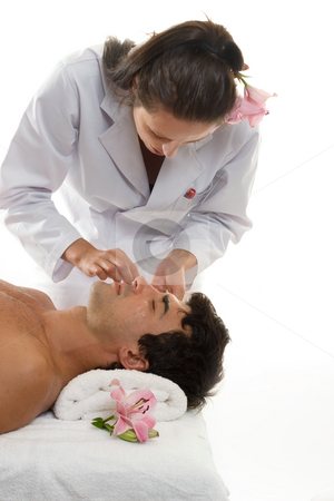 Beautician with Male Client stock photo, Beatician or esthetician treating a male client by Leah-Anne Thompson