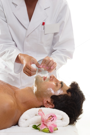 Beauty - Male Facial Salon Treatment Peel stock photo, A salon worker removes a facial peel from a male patron by Leah-Anne Thompson