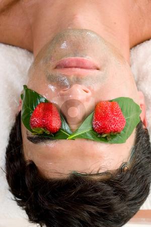 Fruit Acid Mask stock photo, A man enjoys a fruit acid peel by Leah-Anne Thompson