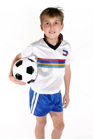 Boy holding a soccer ball stock photo, A child with a soccer ball by Leah-Anne Thompson