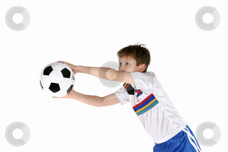 Child playing soccer stock photo, A young boy playing with a soccer ball. by Leah-Anne Thompson