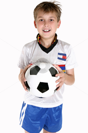Happy boy with a soccer ball stock photo, A happy child holding a soccer ball. by Leah-Anne Thompson