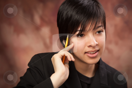 Multiethnic Girl Talking During Portrait. stock photo, Multiethnic Girl Talking During a Studio Portrait. by Andy Dean