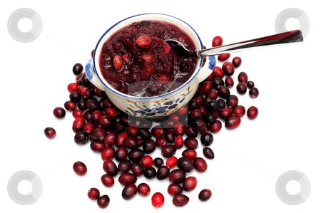 Cranberry Sauce stock photo, Fresh cranberries on a white background with a bowl of cranberry sauce on top of the berries by Lynn Bendickson