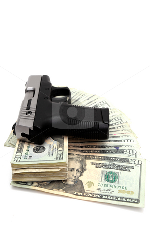 Gun And Money stock photo, A silver and black handgun on top of a stack of United States twenty dollar bills on a white background. by Lynn Bendickson